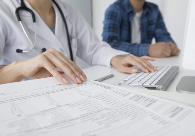 doctor reviewing earned hospital revenue